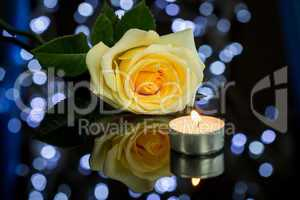 Rose, Candle and Jewelry Present Gift Box on Table
