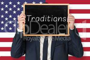 Composite image of businessman holding board