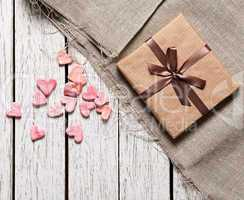 Gift box with heap of small hearts