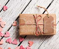 Vintage gift box with blank tag and heap of hearts