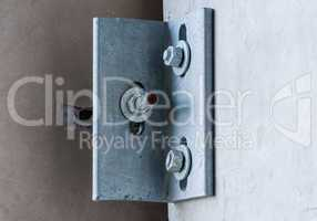 Metal corner bracket on concrete wall