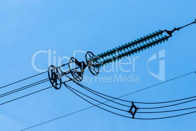 Close-up of power line insulators on sky