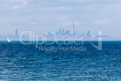 Toronto city skyline across water and fog