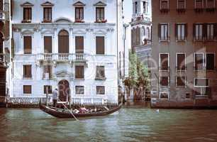 Ancient buildings in Venice. Boats moored in the channel. Gondol