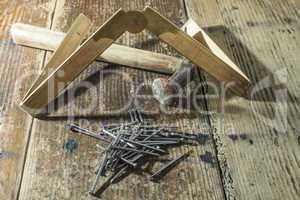 Vintage hammer, nails and wooden centimeter