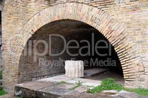 Ancient brick arch at small Roman theater in Taormina, Sicily, Italy