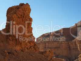 Scenic pillar rock in a stone desert at sunset