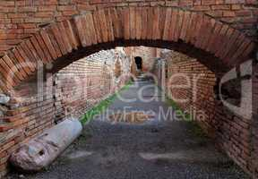 Ancient brick arch under the Roman theater in Taormina, Sicily, Italy