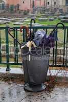 Trash bin full of broken umbrellas