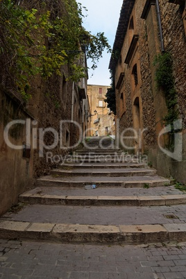 Narrow street with staircase in Piazza Armerina town, Sicily, Italy