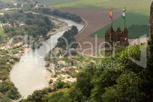 Almodovar Del Rio medieval castle with flags of Spain and Andalusia above Guadalquivir  river