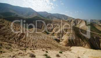 Valley between hills in desert in spring