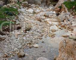 Pebble scree in a small mountain creek