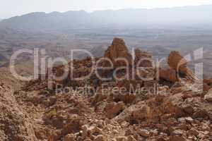 Jagged  rocks at the rim of desert canyon in the Small Crater (Makhtesh Katan) in Negev desert, Israel