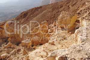 Scenic orange rocks in desert canyon (Small Crater, or Makhtesh Katan in Negev desert, Israel)