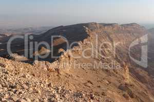 Rim of desert canyon at sunset (Small Crater, or Makhtesh Katan, Negev desert, Israel)