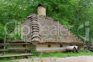 Farmer's house under the thatch roof in open air museum, Kiev, Ukraine