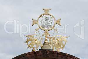 Cross on Orthodox church with Mother Mary and two angels on cloudy sky background