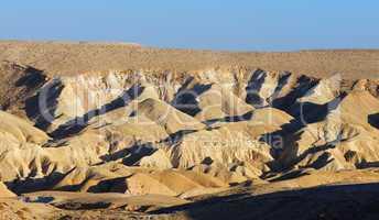 Textured yellow dunes in the desert at sunset in Negev desert, Israel