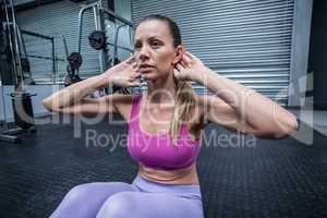 Muscular woman doing abdominal crunch