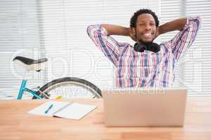 Young businessman relaxes at his place in the office