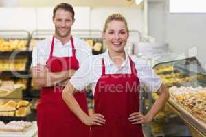 Portrait of two bakers with hands on hips