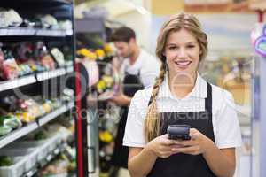 Portrait of smiling pretty blonde woman using handheld