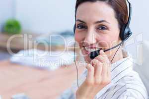 Portrait brunette businesswoman using headphone