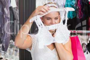 A pretty woman buying bras