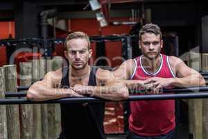 Two muscular men looking at camera