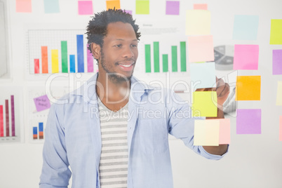 Casual businessman looking at post-it