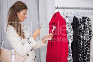 Concentrated woman taking a photo of price tag
