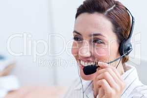 Brunette smiling using headphone