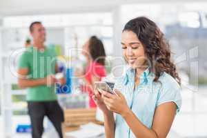 Creative businesswoman texting