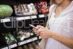 woman buy products and using his smartphone