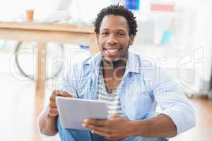 Young creative businessman scrolling on the tablet