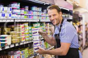 Portrait of a smiling handsome holding a dairy products