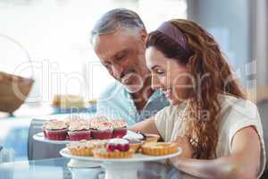 Happy couple looking at pastries