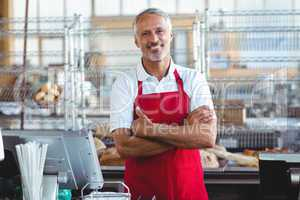 Barista smiling at camera with arms crossed