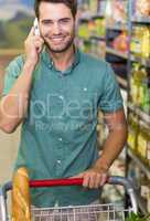 Portrait of smiling man buy food and phoning