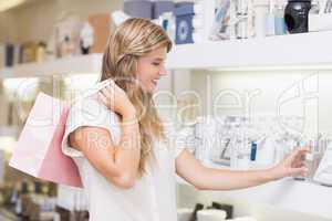 A pretty blonde woman in a perfumery