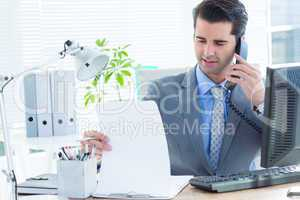 Professional businessman checking at his notebook