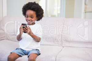 A little boy using a technology