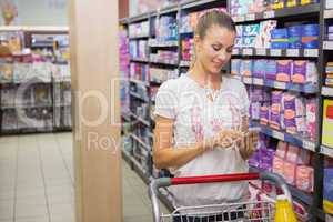 Woman buy products and texting