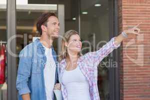 Happy couples looking and pointing far away