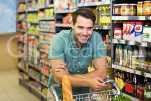 Portrait of smiling man buy food and using his smartphone