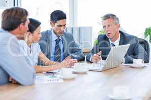 Business people speaking together during meeting