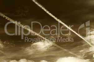 Sepia sky with contrails