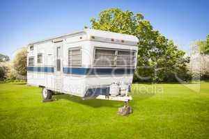 Classic Old Camper Trailer In Grass Field