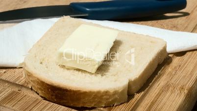 butter melting on a slice of bread